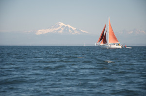 Satori sailing with Mount Baker behind. North of Sucia Island, San Juan Islands, WA