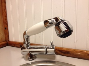 The new faucet with retractable shower head and simple hot/cold-on/off lever.