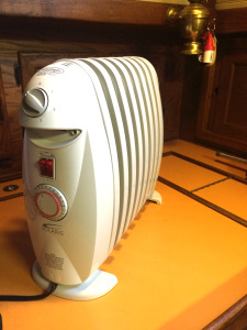 New compact oil heater
