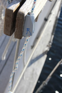 Cleat for the yacht braid on the belay pin rail