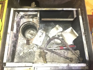 Stove top removed showing the broken cement and fire brick