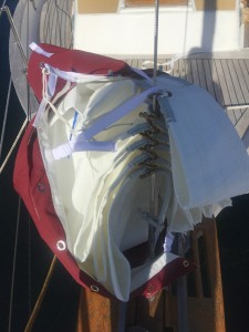 Step 1, Bag the sail enough to get the top webbing strap around the forestay