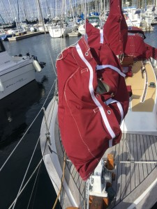Step 3, raise the bag using the halyard to desired height. then pull straps tight until the fasteners line up.