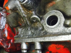 Tackling engine corrosion with an angle grinder and heavy wire head