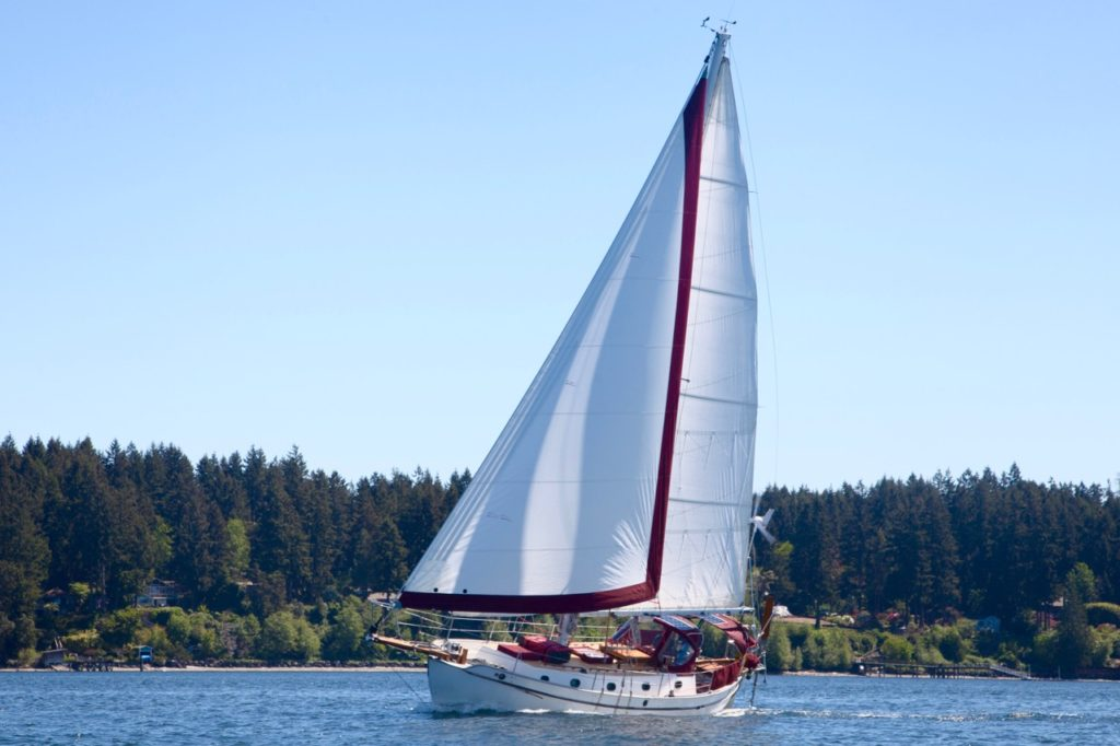 Westsail 32 - Satori sailing to weather, close hauled in fifteen knots of wind