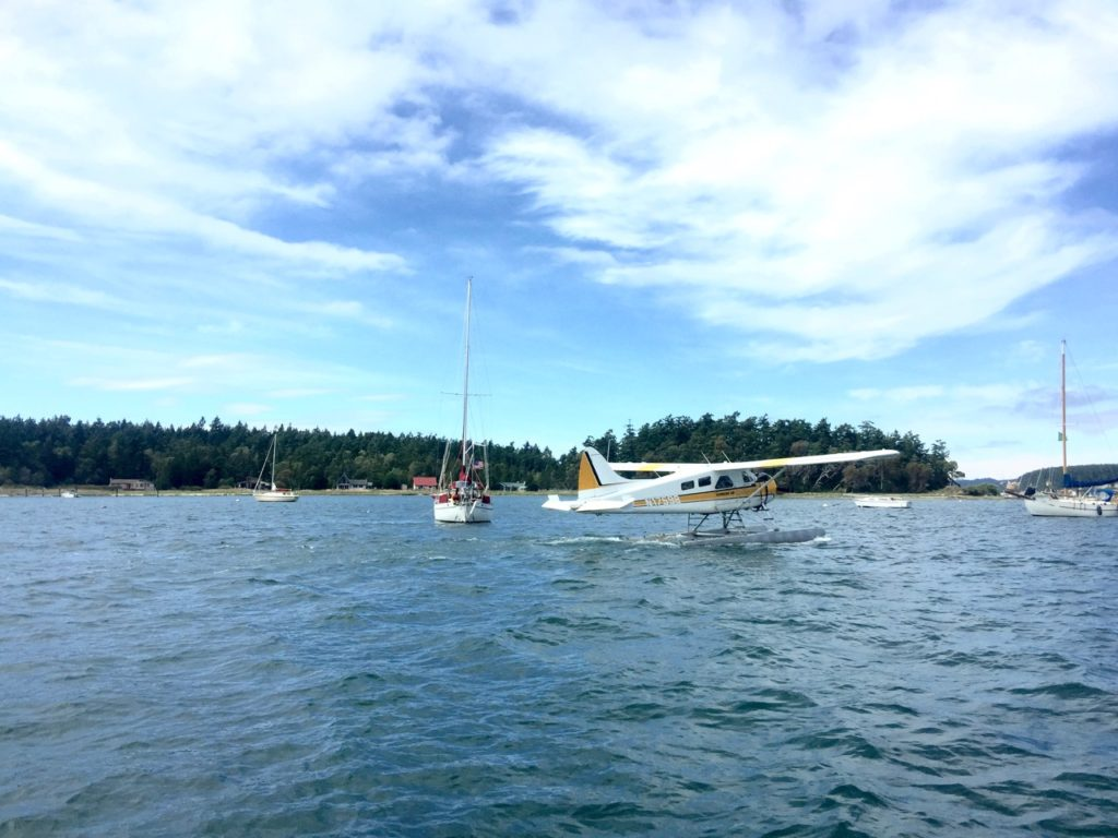A floatplane divides our anchorage, with Satori and Harbinger enjoying fourth of July weekend