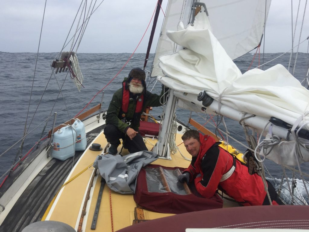 The crew putting away the trysail after the winds subsided